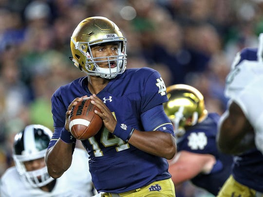 Notre Dame Fighting Irish quarterback DeShone Kizer (14) attempts to throw the ball against the Michigan State Spartans during the first quarter of a game at Notre Dame Stadium.