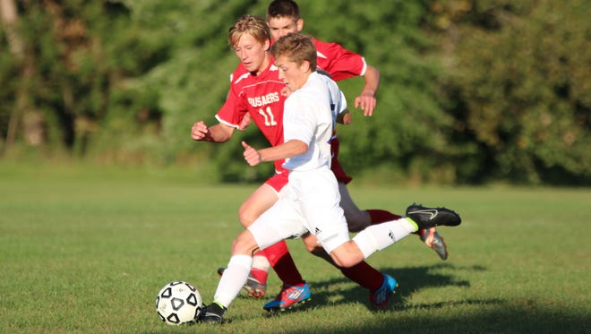 Plymouth Christian's Lucas Albrecht kicks the game-tying goal Tuesday in the second OT.