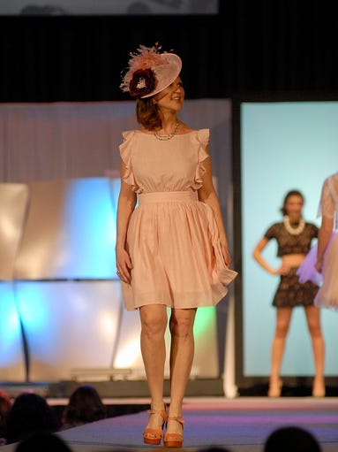 Models on the runway of the Macy's Kentucky Derby Festival
