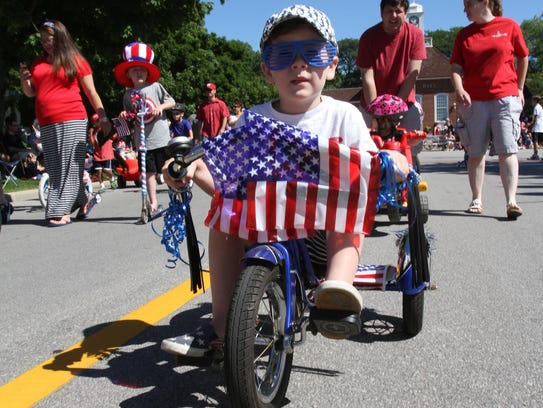 Declan Booth, 4, pedals hard along Broad Street in