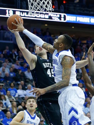 Jan 13, 2015; Newark, NJ, USA;  Seton Hall Pirates forward Brandon Mobley (2) rejects shot of Butler Bulldogs forward Andrew Chrabascz (45) as he drives to the basket at the Prudential Center. Mandatory Credit: Jim O'Connor-USA TODAY Sports