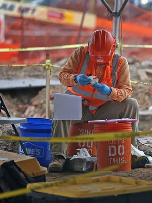 Workers continue an archaeological dig at the IndyGo Downtown Transit Center site, Monday, June 29, 2015.