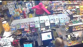 Surveillance footage shows two men police say robbed Rinku's Food Market on Walnut Street in Elmira Nov. 25.