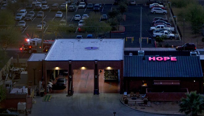 """The word """"HOPE"""" is spelled out on top of Phoenix Fire Department Station 5 near Phoenix Children's hospital on Dec. 16, 2016. Families of young patients say the lights, and their relationship with the firefighters, have been a symbol of inspiration."""