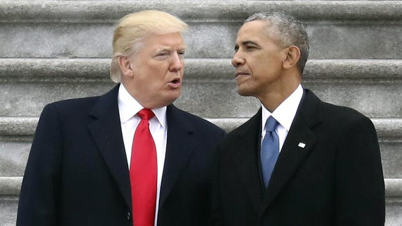 President Donald Trump talks with former President