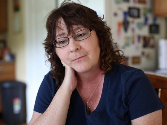 Gina Moore-Yaden sits in her kitchen, tired after making countless phone calls in hopes of finding a treatment center for her 31-year-old son. Moore-Yaden wasn't sure where to start to look for help but, through friends she met in an online Facebook group pointing the way, she has found some resources.