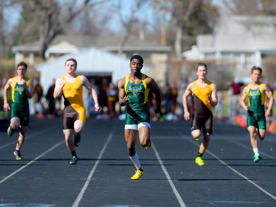 CMR's Damien Nelson runs in 100-meter dash during a