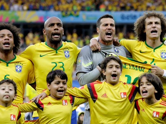 Brazil's goalkeeper Julio Cesar, second right, and David Luiz, right, hold Neymar's jersey during the playing of the national anthem before the World Cup semifinal soccer match between Brazil and Germany at the Mineirao Stadium in Belo Horizonte, Brazil, Tuesday, July 8, 2014. (AP Photo/Natacha Pisarenko)