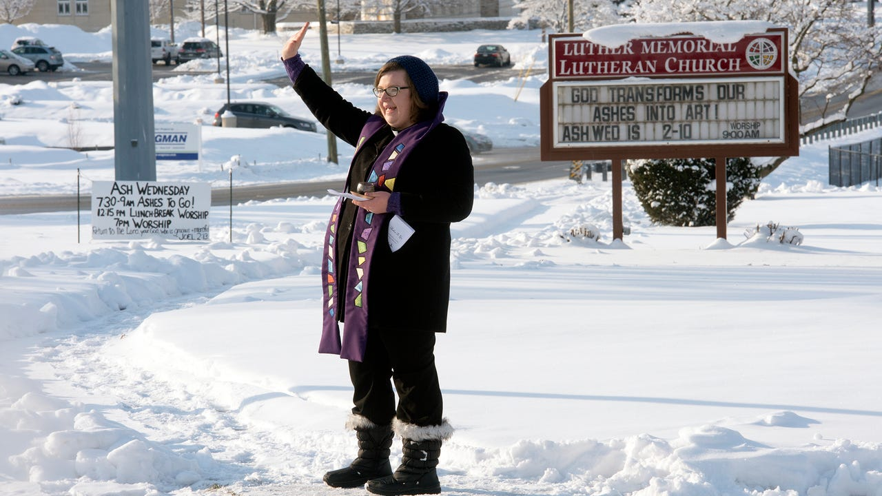 A drive-thru Ash Wednesday service allows Rev. Laura Haupt, of Luther Memorial Lutheran Church, to connect with her community and share an ancient ritual outside her church.