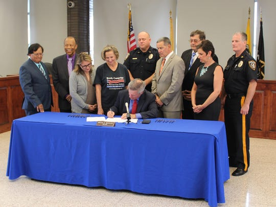 Piscataway Township Mayor Brian C. Wahler signed into law a municipal ordinance that prohibits the retail sale of firearms or ammunition within 1,000 feet of sensitive locations such as schools, day care sites, college campuses, medical facilities, bars, parks, places of worship and similar sites.
