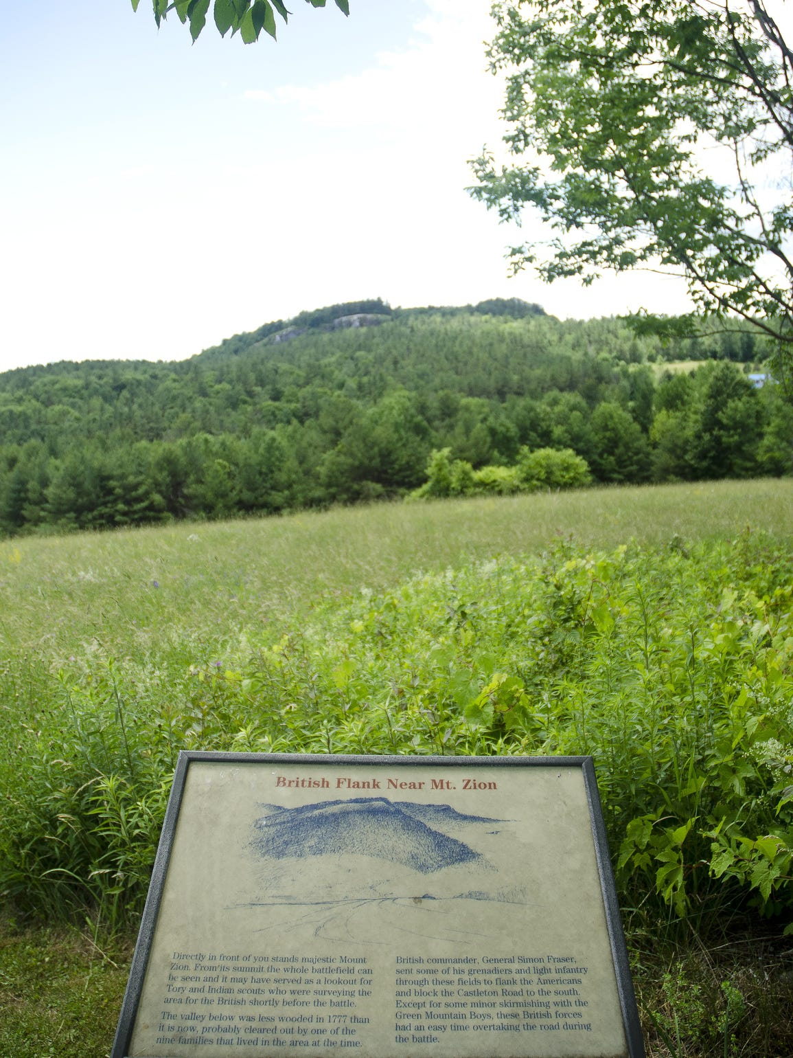 With Mount Zion in the distance, a sign describes how