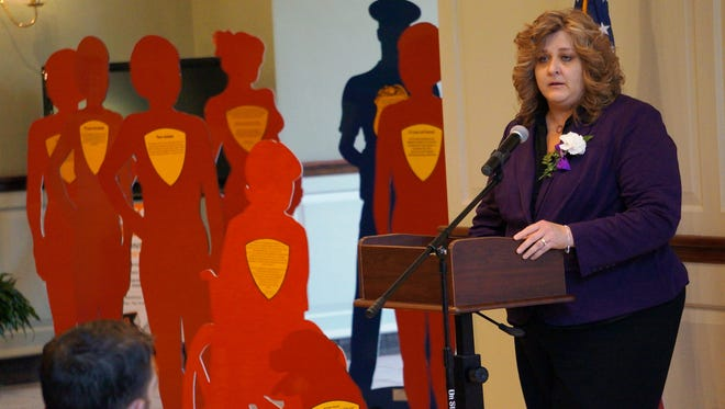 of Mary Pettrow, associate director of Providence House Domestic Violence Services, addressing those gathered at the Silent Witness Project memorial ceremony in Mount Holly Friday.