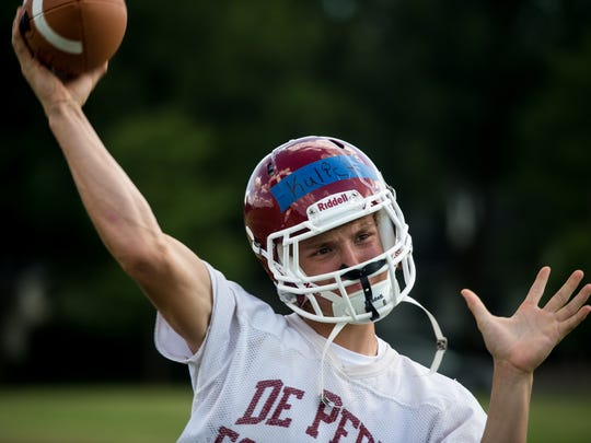De Pere quarterback Emmett Kulick throws the ball during practice last summer at De Pere High School.