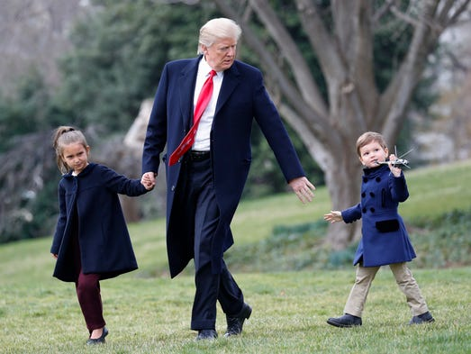 Trump walks with grandchildren Arabella Kushner and
