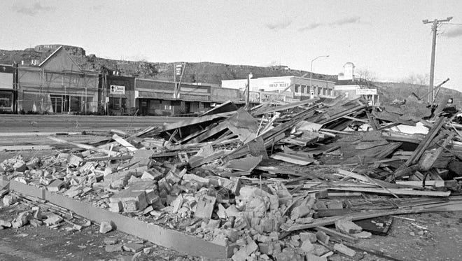 In March of 1992, Spectrum & Daily News photographer Nancy Rhodes captured the then image showing the demolished remains of the Shell gas station that had stood on the corner of St. George Boulevard and Main Street. Zion Bank built their two story structure on the site following the demolition and incorporated a small park-like area filled with a pond, trees, sculptures and plaques noting the history of the area. The storefronts on the north side of St. George Boulevard have since been remodeled, and the new bank building can be seen in the now image taken by Spectrum & Daily News photographer Jud Burkett.