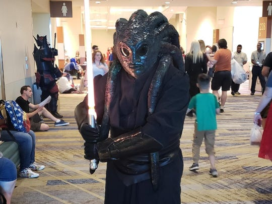 "Dan Gill of San Diego cosplays the cousin of Kit Fisto, a character of his own creation from ""Star Wars"" on Day 3 of Phoenix Comic Fest Saturday, May 26, 2018."