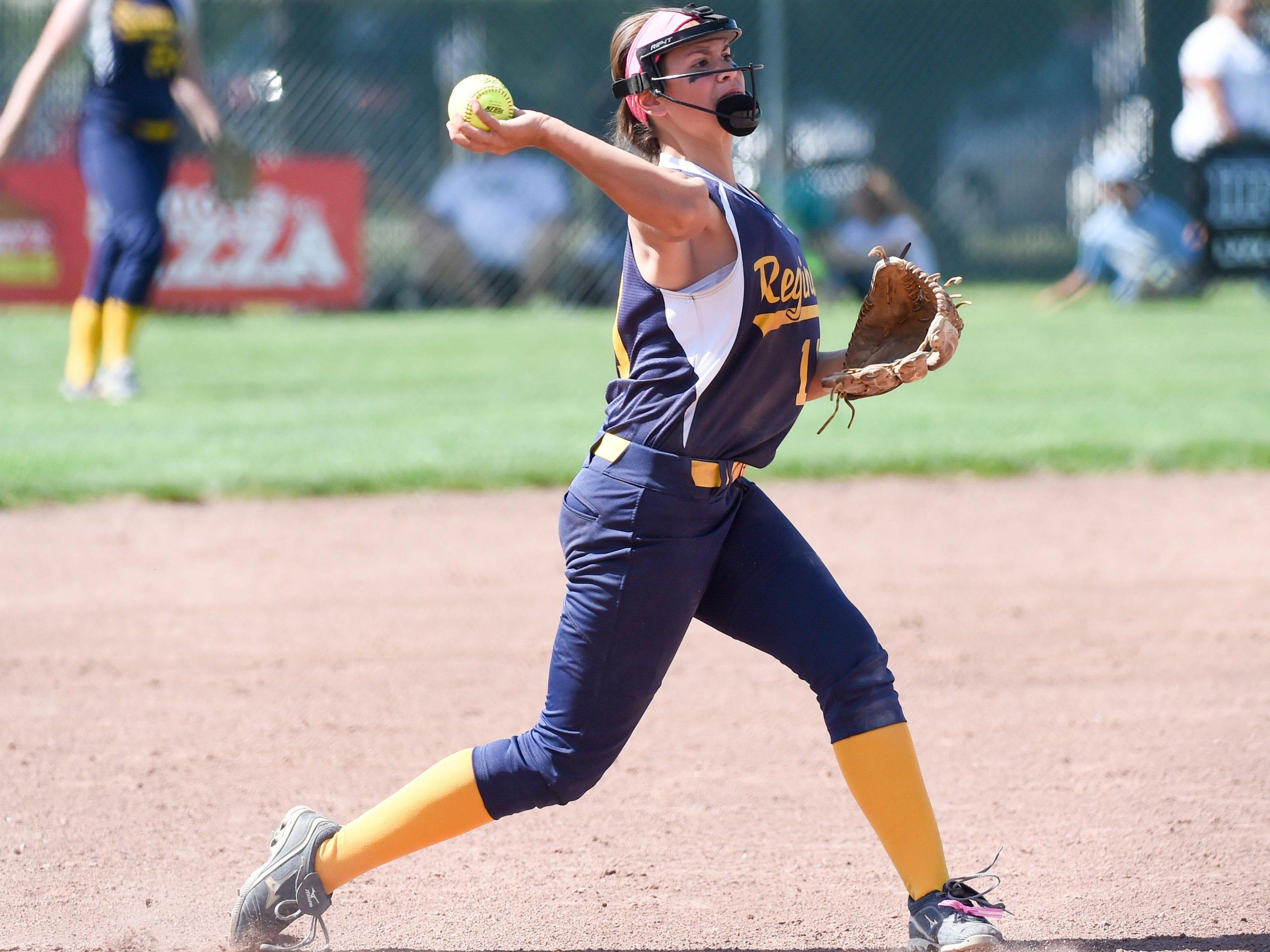 Iowa City Regina third baseman Emily Bonnett (11) makes a throw to first base on Tuesday, July 21, 2015, during the Class 2-A quarterfinals.