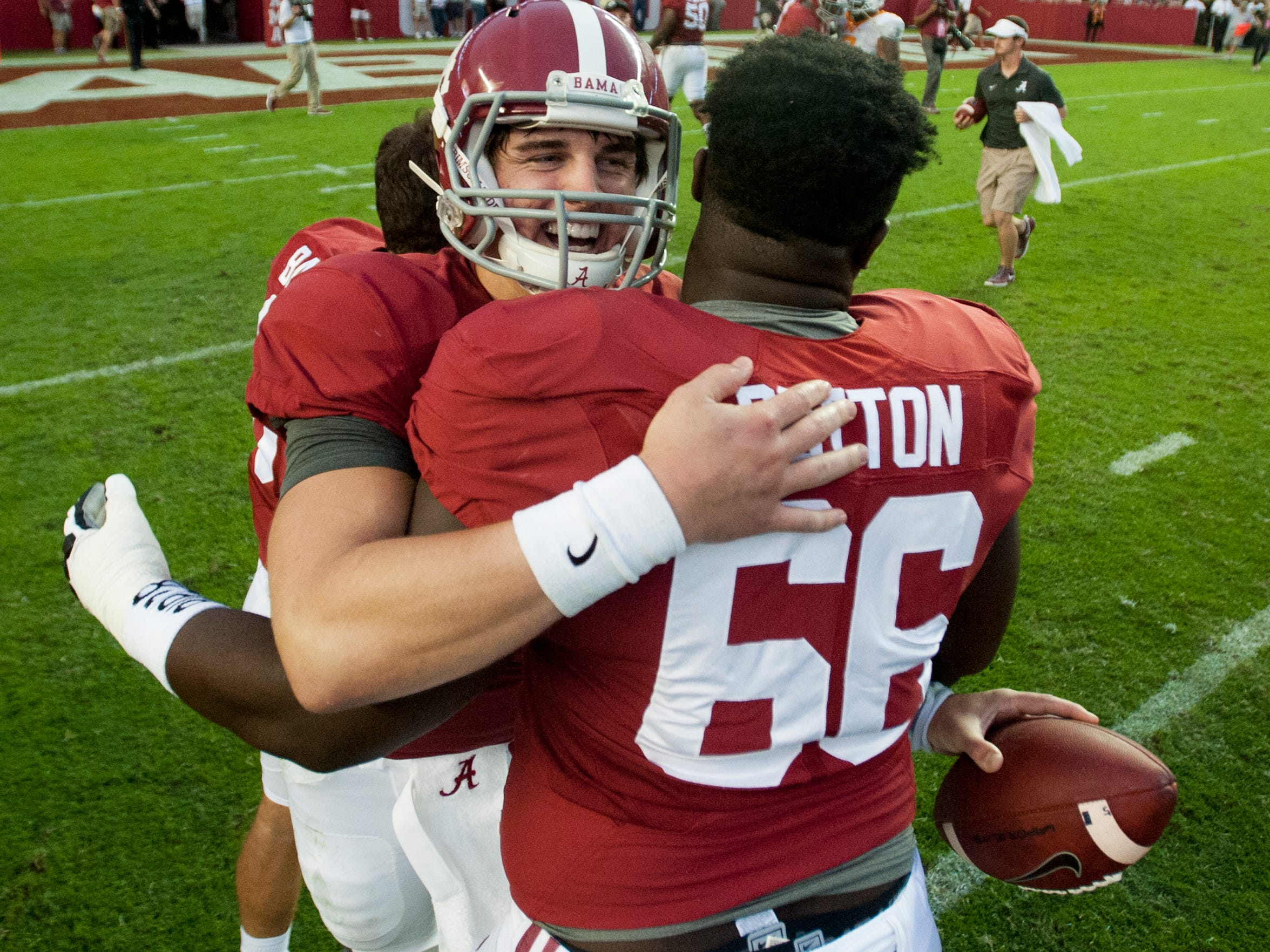 Alabama quarterback Jake Coker (14) celebrates with offensive lineman Lester Cotton (66) after the come from behind win over Tennessee at Bryant-Denny Stadium in Tuscaloosa, Ala. on Saturday October 24, 2015. (Mickey Welsh / Montgomery Advertiser)