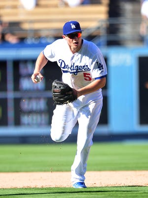 Dodgers shortstop Corey Seager (5) fields a hit in the ninth inning Sunday against the Pirates at Dodger Stadium.