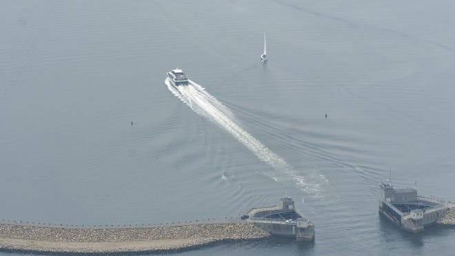 In this file photo, a boat passes through the New Bedford Hurrican Barrier, which protects the city's rich seaport.