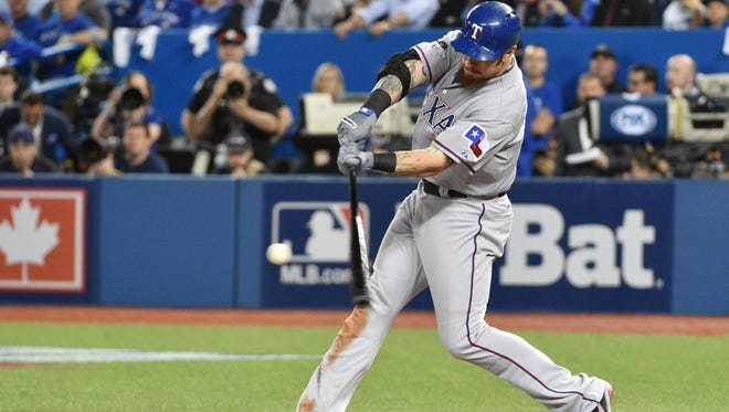 Texas Rangers left fielder Josh Hamilton hits a double against the Toronto Blue Jays in the sixth inning in game five of the ALDS at Rogers Centre in 2015.