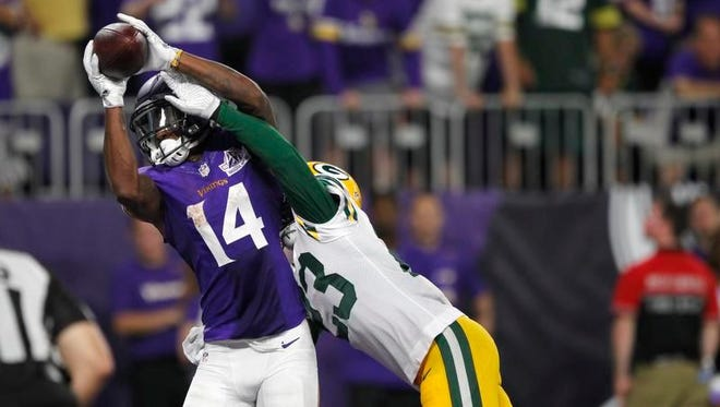Minnesota Vikings wide receiver Stefon Diggs (14) catches a 25-yard touchdown pass over Green Bay Packers cornerback Damarious Randall, right, during the second half of a football game Sunday, Sept. 18, 2016, in Minneapolis.