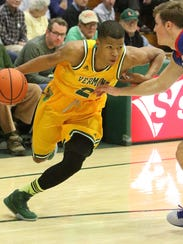 Trae Bell-Haynes drives to the hoop during Monday's