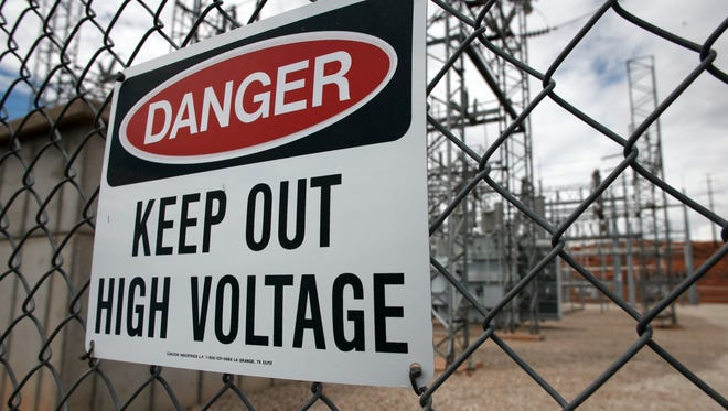 More than 1,000 Navajos who live without electricity in their homes soon could get power for the first time as the tribal utility buys a system of rural Utah substations and electrical lines under the terms of a decades-old deal with a power company. In this file photo taken Monday, August 4, 2014, a danger sign warns away potential trespassers from the equipment at the Skyline Substation in St. George.