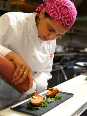 Maneet Chauhan, the executive chef of Chauhan Ale & Masala House in Nashville, creates a dish.