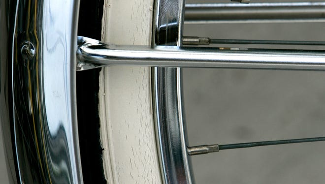 Intricate details are shown on the wheel and tire of a Schwinn Middleweight at an antique bike show at the Otto Grunski Family Festival in Menasha, Wis., Saturday, July 28, 2007.