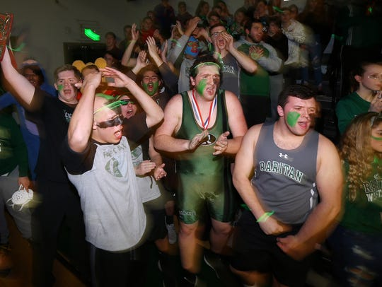 Raritan High student section cheers as the wrestling