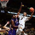 Missouri forward Johnathan Williams III (3) goes for a basket as Lipscomb center Chad Lang (14) commits a foul.