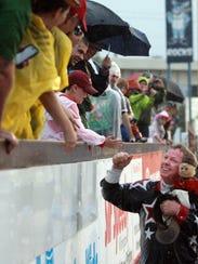 Tim Lepard greets fans at Frawley Stadium in 2013.