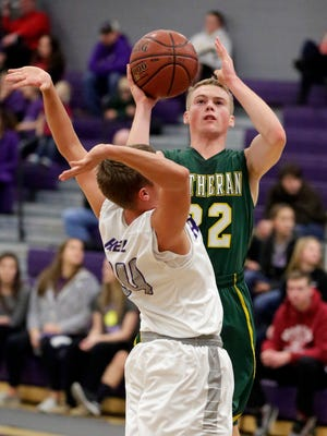 Sheboygan Lutheran's Joshua Pingel (22) aims a shot by Kiel's Trenton Nickel (24) Saturday December 12, 2015 in Kiel.