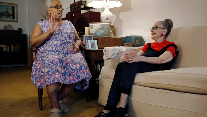 Carolyn Allen, left, recounts how she fell in the bathtub and was helped by roommate Marcia Rosenfeld, right, who owns the Brooklyn, New York apartment where Allen lives. The two women are roommates thanks to a home-sharing program run by a New York-based nonprofit agency.