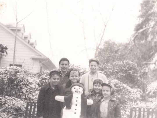 Tom Bordelon, Jim Bordelon, Jim Castille, Matt Moseley, Jane Bordelon, and Dale Bienvenue posing with their snowman in the mid-1950s.