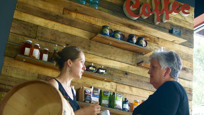 Tennessee Pour House owner Angel Carrier, left, talks with customer Faye Warren during the grand opening of the shop's Gallatin location in 2015.