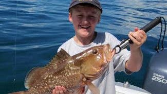 George Aldridge with a 22-inch red grouper, caught on a pinfish 22 miles west of New Pass Monday on an offshore Fishbuster Charter.