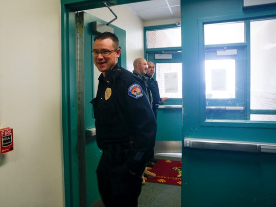Members of the Farmington Police Department visit students and staff members at Mesa Verde Elementary School on Friday in Farmington.