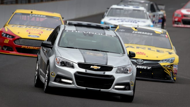 Lauren Holiday leads the field of cars in the official pace car at the beginning of the 22nd Jeff Kyle 400 at the Brickyard Sunday, July 26, 2015, afternoon at the Indianapolis Motor Speedway.