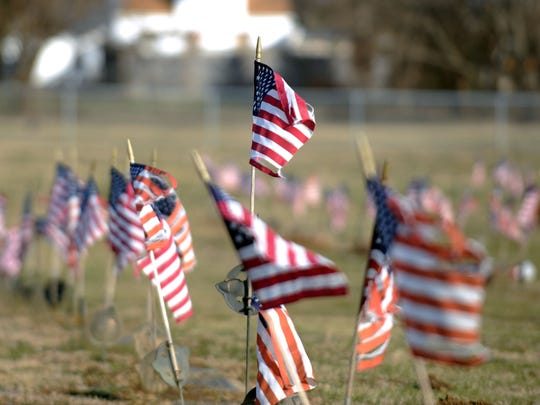 American flags mark the graves of veterans Tuesday, Jan. 30, 2018, at Greenlawn Cemetery in Chillicothe.