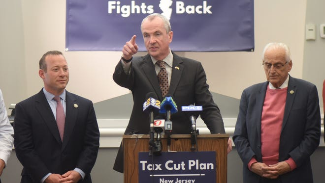 Gov.-elect Phil Murphy, center, Rep. Josh Gottheimer, left, and Rep. Bill Pascrell Jr. announce a plan for New Jersey to fight back against the federal tax hike bill.