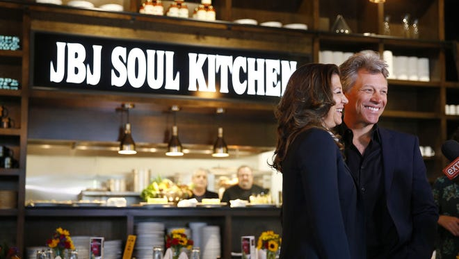 Jon Bon Jovi and his wife Dorothea are all smiles during the grand opening of the newest JBJ Soul Kitchen in Toms River, NJ, Tuesday, May 10, 2016.  The kitchen is part of the BEAT Center which includes a community resource and food pantry along with the restaurant.