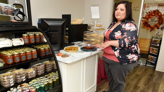Stephanie Heringlake, owner of Steph's Homemade, talks about her line of  gluten-free salsas, banana bread and cookies Wednesday, Oct. 11, that are available at Mixin' It Up Gluten Free Bakery in Sauk Rapids.
