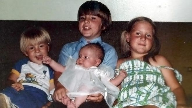 Rachel Jo's baptism in 1982 with siblings, Russell, Robby and Becky.