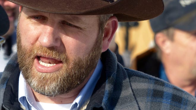 Ammon Bundy participates in a march Saturday, Jan. 2, 2016, on behalf of a Harney County ranching family in Burns, Ore. Bundy, the son of Nevada rancher Cliven Bundy, is leading a group occupying the headquarters of the Malheur National Wildlife Refuge.