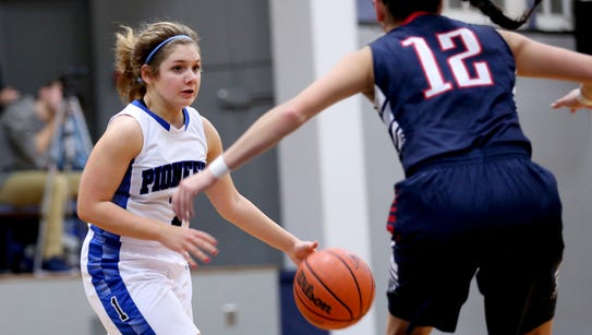 Western Mennonite's Peyton Hopper (1) moves with the