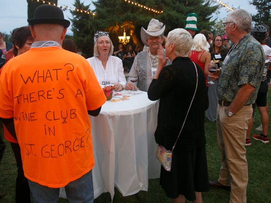 St. George Wine Club members sample wine and socialize at the club's October get-together at the DiFiore Center for the Arts Sunday, Oct. 25, 2015 in St. George.