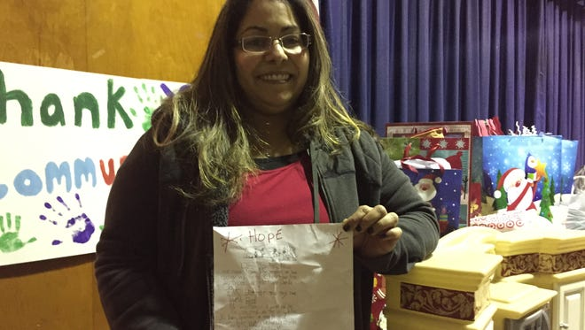 "Melinda Rivera with the ""Dear Santa"" letter she found outside a Stony Point supermarket. Using Facebook, Rivera organized dozens of donations to a local family in need."