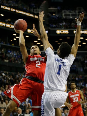 Ohio State's Marc Loving (2) shoots over Kentucky's Skal Labissiere (1) during the first half of an NCAA college basketball game Saturday, Dec. 19, 2015, in New York. (AP Photo/Frank Franklin II)